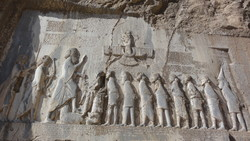 A view of Bisotun bas-relief in Kermanshah Province, western Iran. It is associated with the Achaemenid king Darius I and bears three different cuneiform script languages.