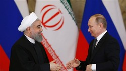 Rouhani and Putin shake hand during their meeting at the Kremlin in Moscow on March 28, 2017.