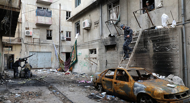 ISIL leader Baghdadi may be in Mosul surrounded by government forces