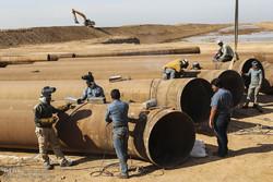 بازدید معاون اول رئیس جمهوری از کانال انتقال آب به عرصه فوق بحرانی گرد و خاک در اهواز