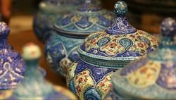 Photo shows a collection of Iranian potteries that are meticulously inlaid with enamel