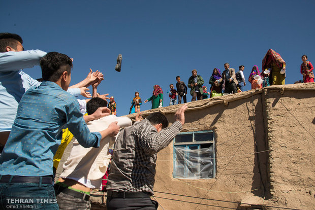 Single men of the village try to catch a shoe thrown from the roof by groom's family. Anyone who catches the shoe receives a reward while returning it to groom's family. Different items including balls, money, toys, and chocolate are thrown by groom's family as a part of the wedding ceremony.