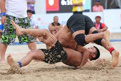 Iranians grab 4 gold, 3 silver medals at Beach Wrestling World C'ships