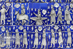 A ceramic tilework bearing historical themes embellishes an exterior wall of the Takieh Mo'aven al-Molk, a distinctive Shiite shrine, in western Iranian city of Kermanshah, April 25, 2017.