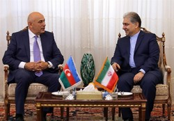 Azerbaijan's Deputy Culture and Tourism Minister Adalat Veliyev (L) talks to East Azarbaijan Province Governor General Esmaeil Jabbarzadeh in Tabriz on April 26, 2017.