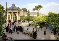 Clusters of natives and travelers mark the national Shiraz Day during their visit to Hafezieh where Hafez, an illustrious 14th-century Persian poet, is laid to rest in the southern Iranian city on May