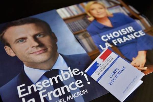 فوز ايمانويل ماكرون على منافسته ماري لوبن في انتخابات الرئاسة الفرنسية