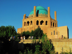 People visit the 14th-centuruy Mausoleum of Oljaytu, a UNESCO site located in Soltaniyeh, Zanjan province
