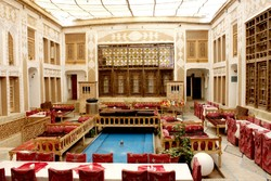 An interior view of Malek al-Tojjar boutique hotel, which has been repurposed from a historic mansion in Yazd.