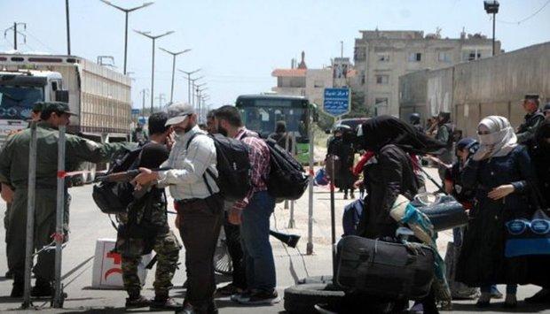 460 militants leave al-Waer neighborhood
