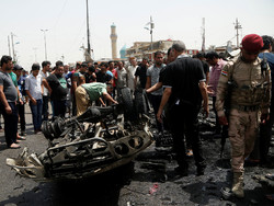 18 killed in twin suicide car attacks in Baghdad