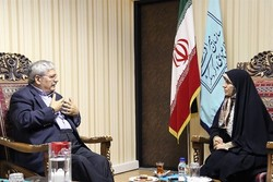 ICCROM Director-General Stefano De Caro (L) talks to Iran's tourism chief Zahra Ahmadipour in Tehran, May 3, 2017.