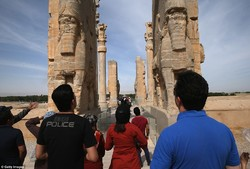 Tourists walk through the Persepolis archeological site in southern Iran. It was a ceremonial capital of Persian Achaemenid Empire (c. 550–330 BC).