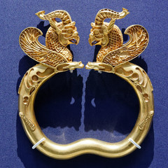 A prehistoric Iranian gold griffin-headed armlet dating back to the Achaemenid era (c. 550 – 330 BC).