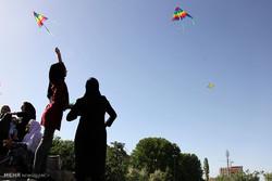 Children fly kites in Sanandaj