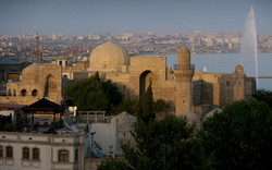 Walled City of Baku with the Shirvanshah's Palace and Maiden Tower in the foreground. The UNESCO-registered site is amongst key tourist attractions in Azerbaijan.