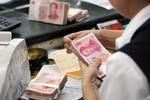 بانکهای چین برای تقویت یوآن بازهم دلار فروختند