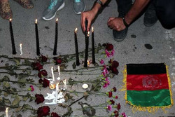 Iranians light candles at Consulate General of Afghanistan