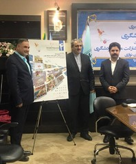 CHTHO Deputy Director Morteza Rahmani-Movahhed (R) attends an unveiling ceremony for the poster of the 4th national festival of tourism partnership in Tehran on June 11, 2017.