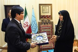 Iran's tourism chief Zahra Ahmadipour (R) presents a gift to Vietnam's Ambassador Nguyen Hong Thach in Tehran, June 20, 2017.