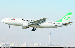 An undated photo depicts a Mahan Air passenger jet taking off from Tehran's Mehrabad International Airport over the city skyline.
