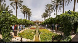 An undated photo released by IRNA depicts people visiting an enormous mansion set within the well-manicured Narenjestan garden, itself a major tourist destination in Shiraz, southern Iran.