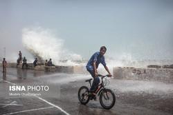 Children enjoy high waves in Bandar Abbas