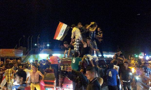 """احتفالات تعم العراق فرحا بالانتصار على """"داعش"""""""