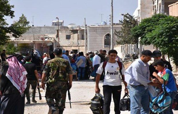 More families return to al-Waer neighborhood in Homs