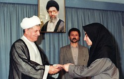 Maryam Mirzakhani is accepting a present from late Akbar Hashemi Rafsanjani, the fourth President of Iran, upon her gold medal of International Mathematical Olympiad in 1995.