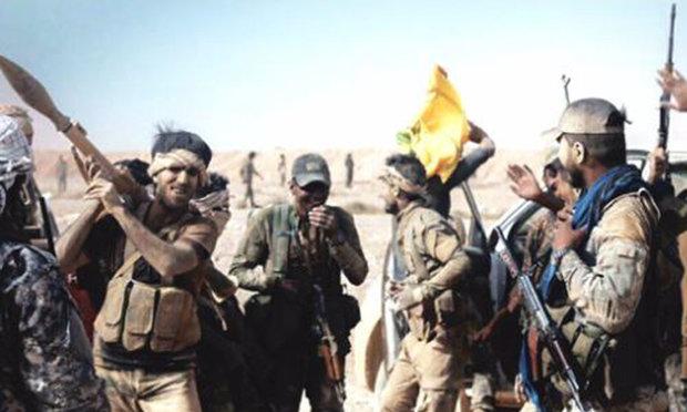 """الحشد الشعبي يضبط بزات عسكرية بكميات هائلة في مضافات """"داعش"""""""