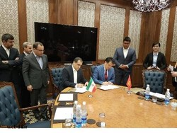 Iran's Health Minister Hassan Qazizadeh-Hashemi (L) and his Kyrgyz counterpart Talantbek Batyraliev sign agreements in the field of health