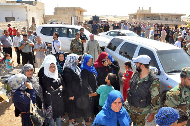 Hundreds of displaced families return to their homes in northern Hama