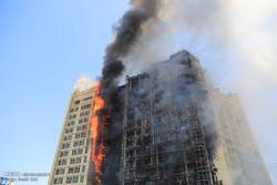 حريق يشب في احدى مباني مدينة مشهد المقدسة/صور