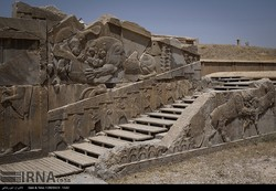 Photo depicts a stone staircase dominated by magnificent bas-relief carvings at Persepolis, a UNESCO World Heritage site in southern Iran, July 15, 2017
