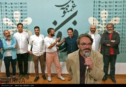"""Composer Hossein Alizadeh speaks during the unveiling of """"The Sad Story of Fereidun"""" at Tehran's Niavaran Cultural Center on July 22, 2017. (IRNA/Mohsen Sajjadi)"""