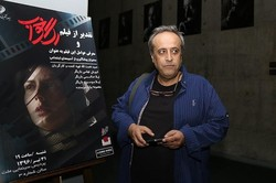 """Director Hamid Nematollah attends a screening of his latest film """"Subdued"""" at Tehran's Mallat Cinema Complex on July 22, 2017. (ISNA)"""