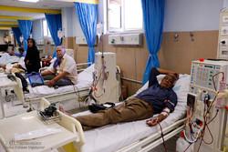 عیادت خدام حرم رضوی از بیماران بیمارستان شفا در کرمان