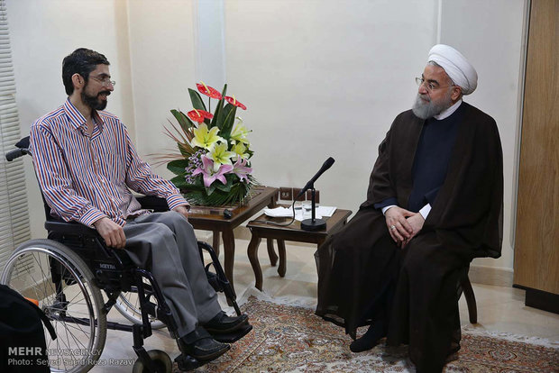 Rouhani visits families of war veterans, martyrs
