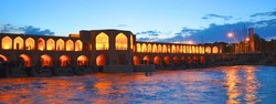 People revel in the peaceful atmosphere of Pol-e Khaju in Isfahan. The 17th-century bridge is lit by glorious colors at dusk.