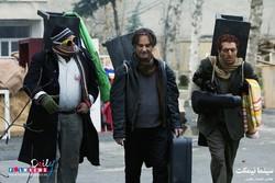 "Hooman Barqnavard (L), Ali Omrani (C) and Ashkan Khatibi act in a scene from ""Bench Cinema"" by the Iranian director Mohammad Rahmanian. (Photo by Ehsan Neqabat)"