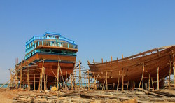 Photo depicts traditional Lenj vessels being built in southern coasts of Iran. Traditional skills of building and sailing Iranian Lenj boats in the Persian Gulf added to the UNESCO list of Intangible