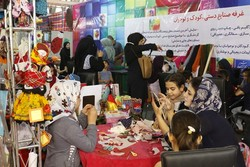 Children attend a special training session at the 28th National Crafts Exhibition in Tehran on August 23, 2107.