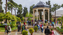 This file photo shows people visiting the tomb of the Persian poet Hafez in the southern Iranian city of Shiraz.