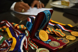 Former wrestling champ. bestows medals to Imam Reza Museum