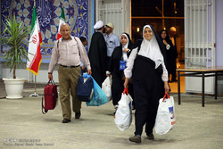 Iranian Hajj pilgrims return home