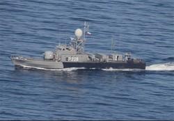 Iranian vessel turns away U.S. warship