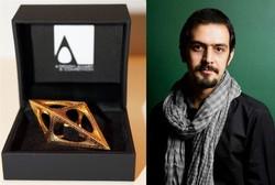 The combination photo shows Iranian graphic designer Turaj Saberivand and an A' Design Award.