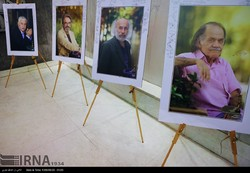 Stands set up at Eyvane Shams Hall in Tehran show pictures of the art elites (left to right) Mohammad-Hassan Khoshnevis, Hossein Alizadeh, Kianush Ayyari and Sirus Ebrahimzadeh.