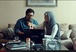 "Farhad Aslani (L) and Pantea Panahiha act in a scene from Arian Vazirdaftari's short drama ""Not Yet""."
